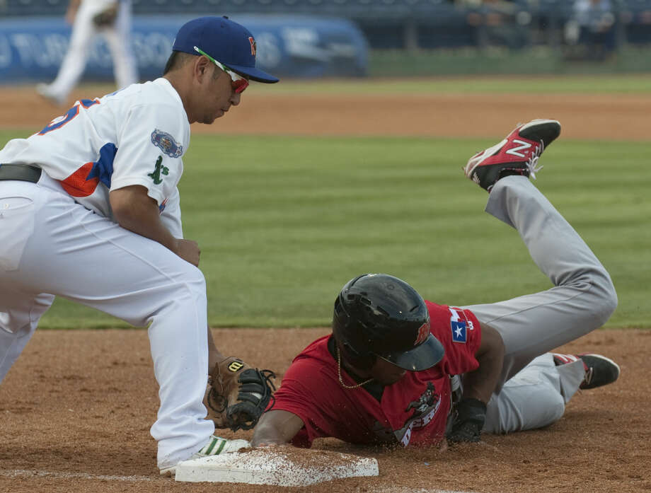 RockHounds first baseman Hiro Nakajima attempts to make the tag on a pickoff but RoughRiders' Nick Williams beats the throw Monday at Security Bank Balpark. Tim Fischer\Reporter-Telegram Photo: Tim Fischer