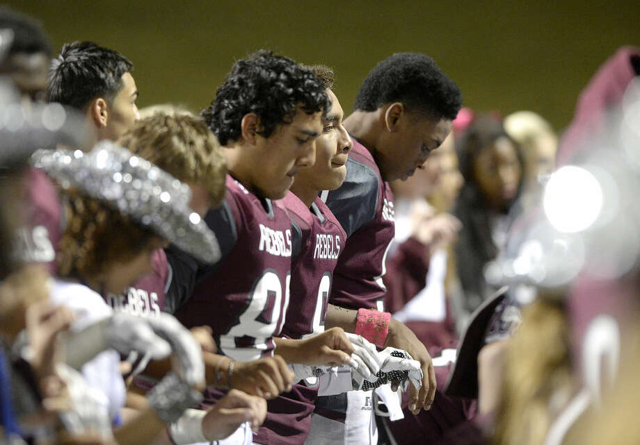 Lee football players stand together as the band plays following a loss in overtime against San Angelo Central on Friday, Oct. 30, 2015, at Grande Communications Stadium. James Durbin/Reporter-Telegram Photo: James Durbin