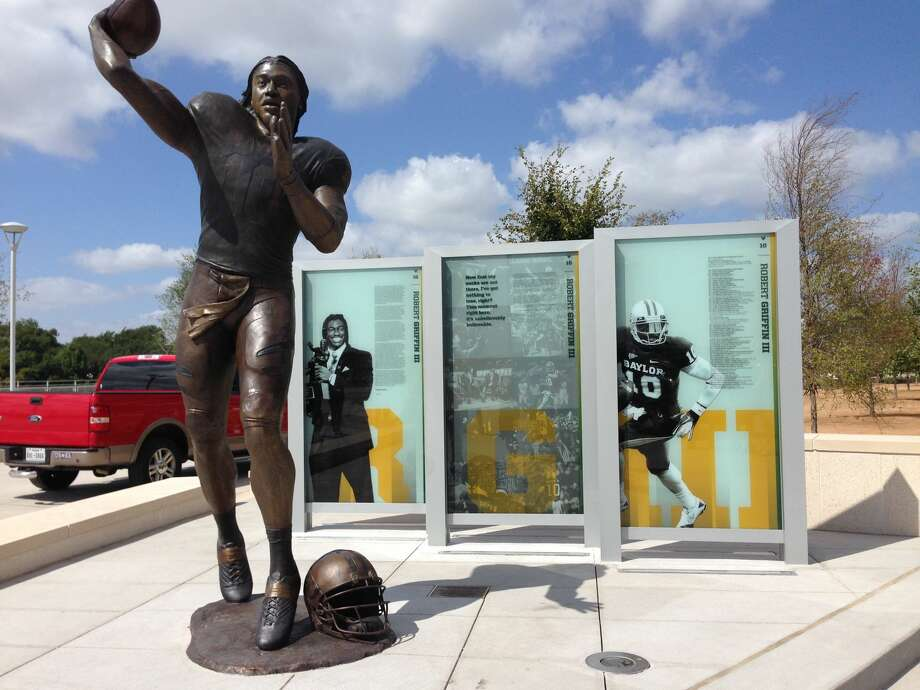 Midland native Tom White created this statue of former Baylor University quarterback Robert Griffin III. The statue of the Heisman Trophy winner   stands outside McLane Stadium and was unveiled Aug. 31. Photo:  Courtesy Photo