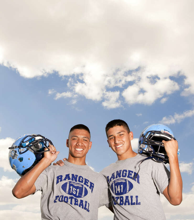Brother greenwood football players Fabian Madrid (left) and Faustino Madrid (right) pose for a photo Thursday at Greenwood High. James Durbin/Reporter-Telegram Photo: James Durbin