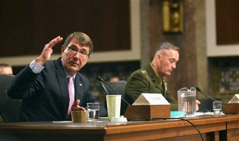Defense Secretary Ash Carter, accompanied by Joint Chiefs Chairman Gen. Joseph Dunford, testifies on Capitol Hill in Washington, Tuesday, Oct. 27, 2015, before the Senate Armed Services Committee. Carter said Tuesday that the U.S. is willing to step up unilateral attacks against Islamic State militants in Iraq or Syria, a signal that the U.S. would escalate American involvement beyond airstrikes by giving the go-ahead for U.S. special operations forces' raids on the ground. (AP Photo/Kevin Wolf) Photo: Kevin Wolf