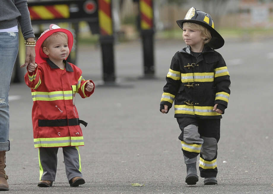 The Midland Fire Department hosted a Truck Or Treat event on Saturday, Oct. 24, 2015, at the Central Fire Station which included a haunted house, bucket rides, booths, games and candy. James Durbin/Reporter-Telegram Photo: James Durbin