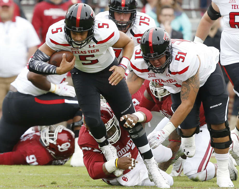 Texas Tech quarterback Patrick Mahomes (5) is pulled down by Oklahoma defensive tackle Jordan Wade, bottom, in the first quarter of a game in Norman, Okla., Saturday, Oct. 24, 2015. (AP Photo/Sue Ogrocki) Photo: Sue Ogrocki