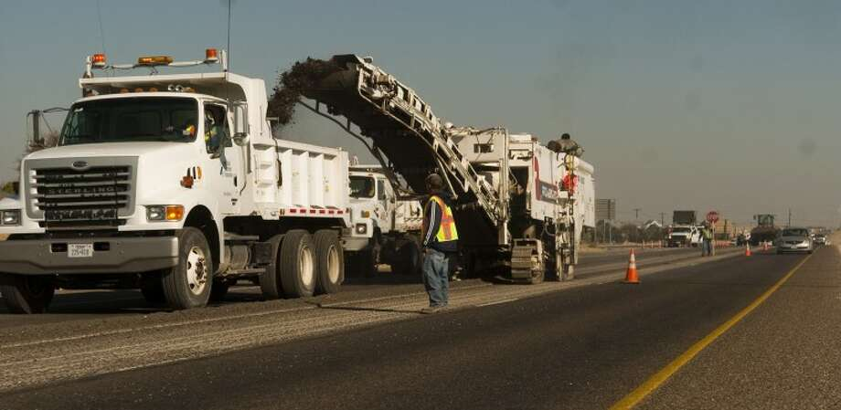 A file photo shows Texas Department of Transportation and Jones Brothers Dirt and Paving road crews resurfacing a section of Loop 250.