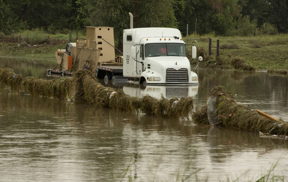 A semi submerged 18-wheeler sits stuck Thursday 10-22-2015 on E. Golf Course just east of Fairgrounds Road after trying to cross the road where Scharbauer Draw crosses the roadway. Tim Fischer\Reporter-Telegram Photo: Tim Fischer