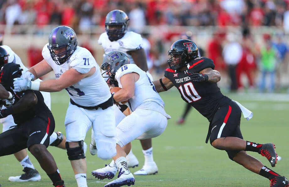 Texas Tech linebacker Pete Robertson (10) grabs hold of Central Arkansas quarterback Taylor Reed and sacks him for a loss in the Red Raiders' home opener last Saturday night at Jones AT&T Stadium. Photo: Wade H Clay