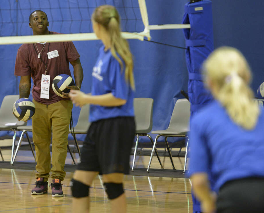 Marcus Johnson helps out during 8th grade volleyball practice Wednesday 10-21-2015 as part of the pilot program Dads on Campus at Abell Junior High. Tim Fischer\Reporter-Telegram Photo: Tim Fischer