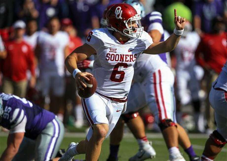 Oklahoma quarterback Baker Mayfield (6) scrambles with the ball during the first half of an NCAA college football game against Kansas State in Manhattan, Kan., Saturday, Oct. 17, 2015. (AP Photo/Nati Harnik) Photo: Nati Harnik