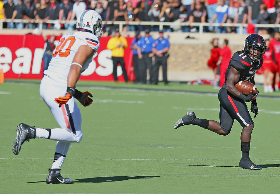 Texas Tech receiver Jakeem Grant (11) heads up field after hauling in a pass in Saturday's Big 12 action at Jones AT&T stadium in Lubbock. Photo: Wade H. Clay/Special To The Reporter-Telegram