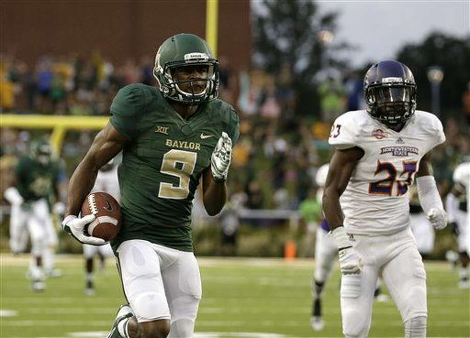 Baylor wide receiver KD Cannon (9) sprints to the end zone after a reception for a touchdown as Northwestern State cornerback Fred Thomas (23) gives chase in the first half of an NCAA college football game, Saturday, Sept. 6, 2014, in Waco, Texas. (AP Photo/Tony Gutierrez) Photo: Tony Gutierrez