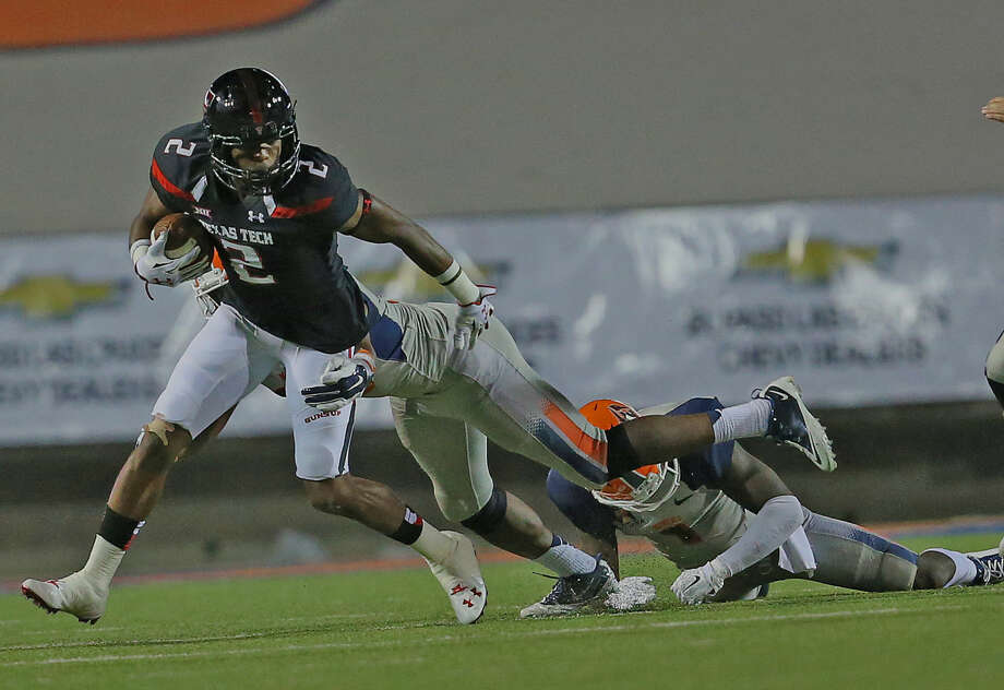 Red Raider receiver Reginald Davis tries to break free and gain more yards against the UTEP Miners. Photo: Wade H Clay
