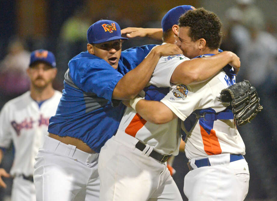 Midland RockHounds Jefry Marte (left), pitcher Jose Flores (center) and Bruce Maxwell (right) celebrate a win against Frisco in the Texas League South Division Championship Series on Saturday at Security Bank Ballpark. The RockHounds beat Frisco 5-4 to win the series 3-1. James Durbin/Reporter-Telegram Photo: James Durbin