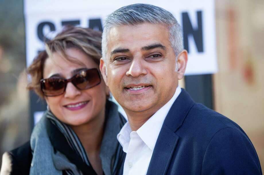 Sadiq Khan, the Labour Party candidate for London mayor, and his wife Saadiya Khan, pose for photographers after voting in the Mayor of London and London Assembly elections in London, U.K., on Thursday, May 5, 2016. Britain goes to the polls Thursday in a series of local and legislative elections that will deliver a new mayor for London, continued nationalist government in Scotland and the voters' first verdict on Jeremy Corbyn's leadership of the opposition Labour Party. Photographer: Simon Dawson/Bloomberg *** Local Caption *** Sadiq Khan; Saadiya Khan Photo: Simon Dawson, Stringer / © 2016 Bloomberg Finance LP