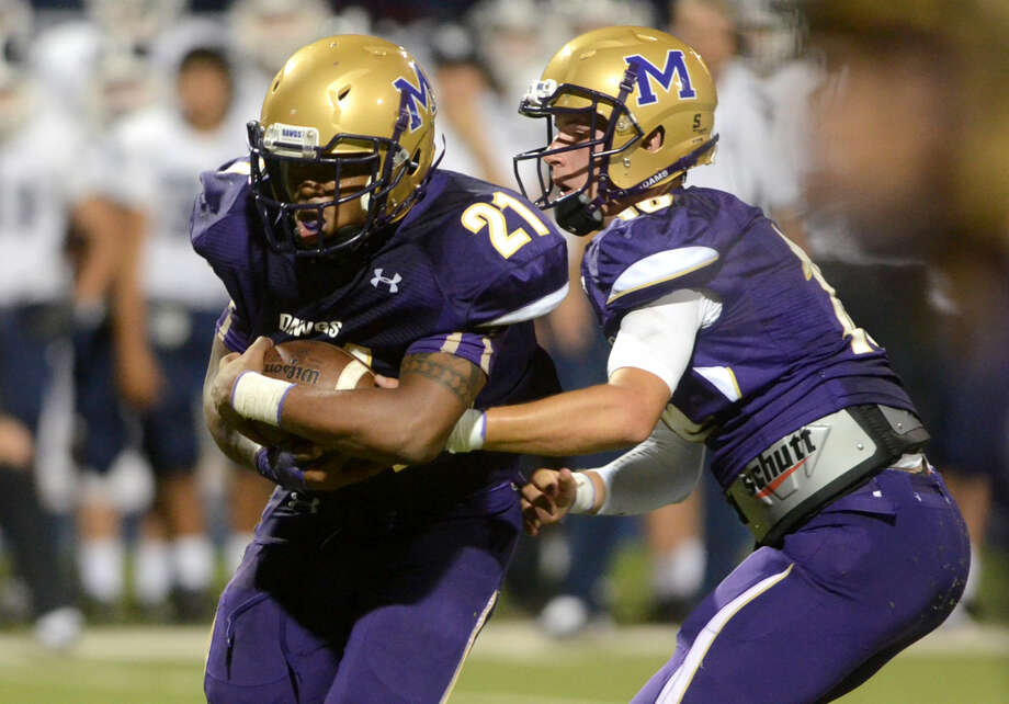 Midland High's Darius Reed accepts a handoff from quarterback Ryan Goodrum during the game against Smithson Valley on Friday at Grande Communications Stadium. Midland High beat Smithson 33-26 in double overtime. James Durbin/Reporter-Telegram Photo: James Durbin