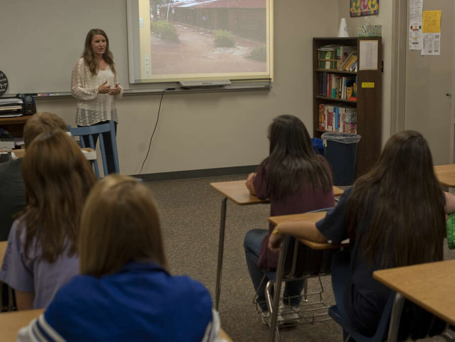 Emily Hood, Trinity graduate, speaks Friday about her work and orphanage in Ghana.  Photo: Tim Fischer/Reporter-Telegram