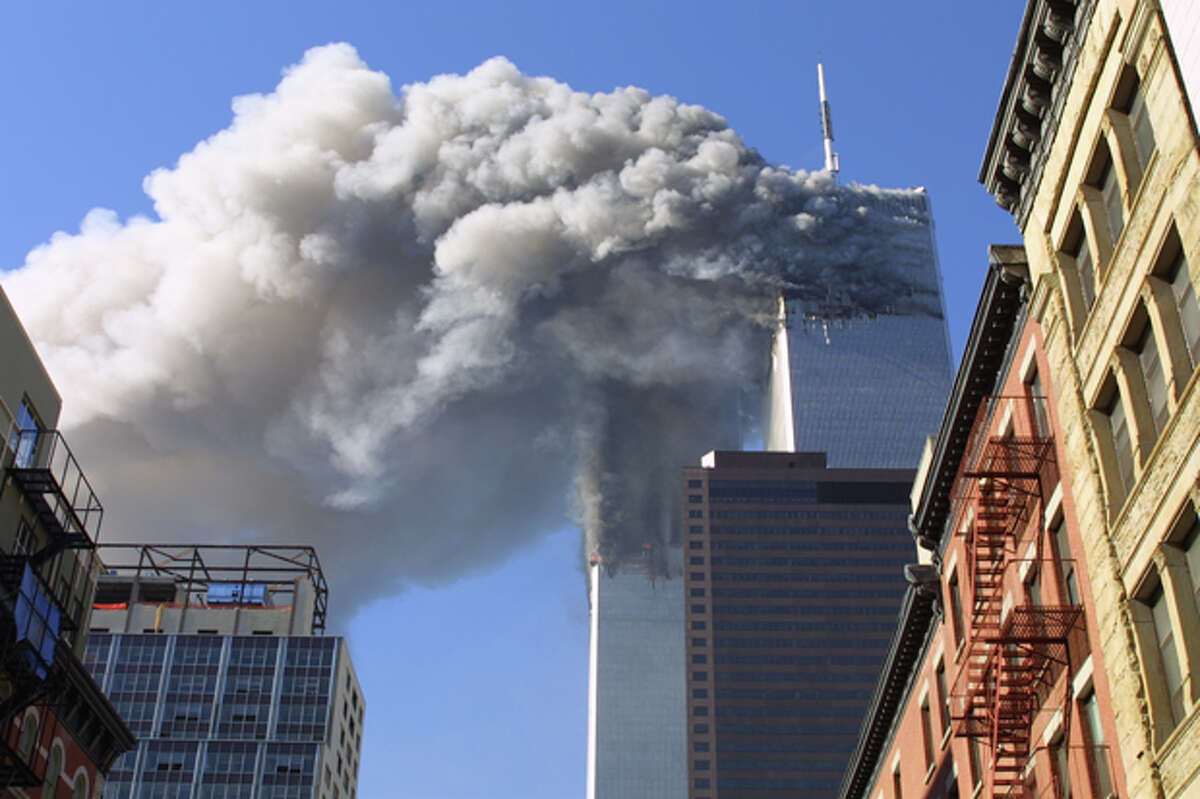 FILE - In this Sept. 11, 2001 file photo, the twin towers of the World Trade Center burn after hijacked planes crashed into them in New York.