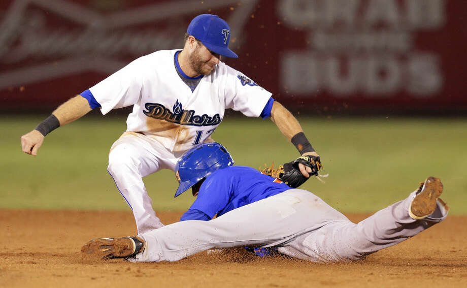 Drillers second baseman Taylor Featherston makes the tag on Rockhounds runner Daniel Robertson on an attempted steal during the second playoff game of their series in Tulsa, OK, Sept. 10, 2014. MICHAEL WYKE/Tulsa World Photo: Michael Wyke