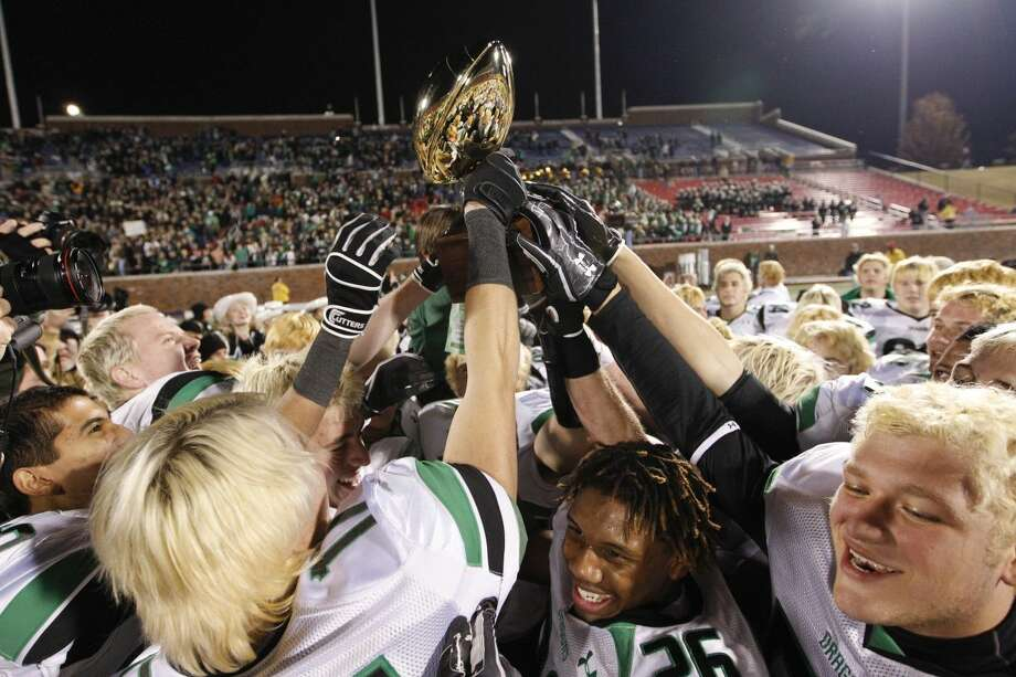 Southlake Carroll High School vs. Dallas Skyline. Southlake Carroll football players celebrate with the semifinal trophy after beating Dallas Skyline in UIL 5A Division 1 semifinal football game at Ford Stadium on the SMU campus in Dallas, Texas, Saturday, December 10, 2011. Southlake Carroll won 28-24 (Special to the Fort Worth Star-Telegram/Jim Cowsert) Photo: Jim Cowsert/Fort Worth Star-Telegram