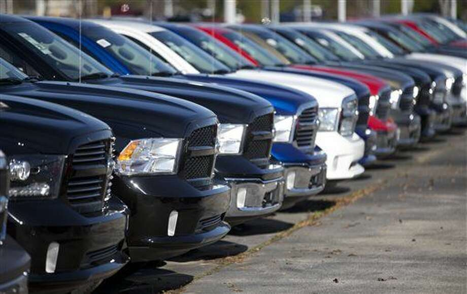 FILE - In this Jan. 5, 2015 file photo, Ram pickup trucks are on display on the lot at Landmark Dodge Chrysler Jeep RAM in Morrow, Ga. Fiat Chrysler sold almost 41,000 Rams in October 2015, the company reported Tuesday, Nov. 3, 2015, a 3 percent gain over a year ago for FCA's top-selling vehicle. (AP Photo/John Bazemore, File) Photo: John Bazemore