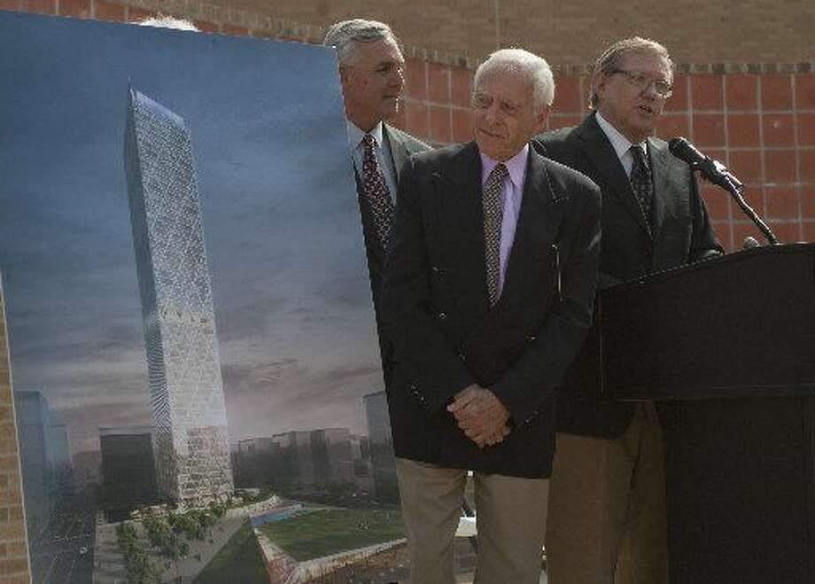 "In this file photo, Bill Meyer looks over a conceptual drawing of Energy Tower as Wendel ""Scooter"" Brown talks about it with then Mayor Wes Perry during a press conference in March 2013. Developers Energy Related Properties announced Wednesday they are canceling the project. Photo: Tim Fischer/Reporter-Telegram"
