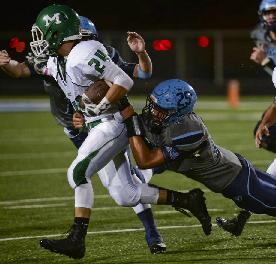 Monahans' Maurilio Marquez looks for more yards as Greenwood's Fabian Madrid holds on Friday 10-30-2015 at J.M. King Memorial Stadium. Tim Fischer\Reporter-Telegram Photo: Tim Fischer