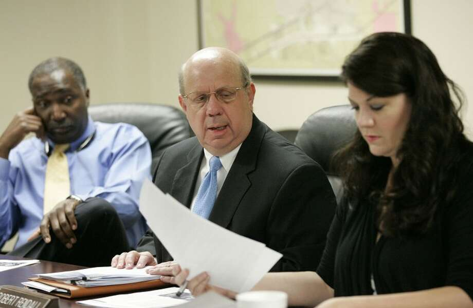 FILE PHOTO: Midland Development Corp. board members Cary Love, from left, Robert Rendall Jr. in the Reporter-Telegram file photo.  Photo: Cindeka Nealy