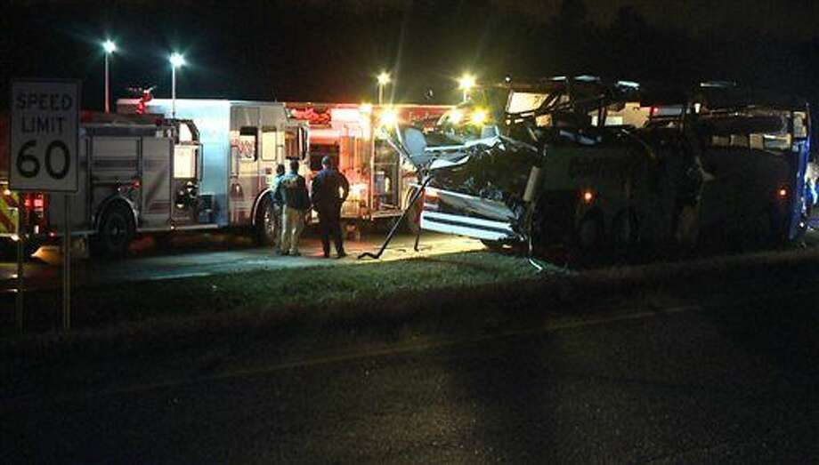 This photo provided by KTHV in Little Rock shows emergency personnel at the scene of an accident after a charter bus ran off Interstate 40 and hit a bridge abutment on Friday, Nov. 6, 2015 in North Little Rock Ark. Some passengers were killed in the crash along with several injuries. A heavy storm had recently passed through the area and left light rain and fog in its wake, but it wasn't immediately known if weather played a role. (Photo courtesy of KTHV via AP) MANDATORY CREDIT Photo: HONS