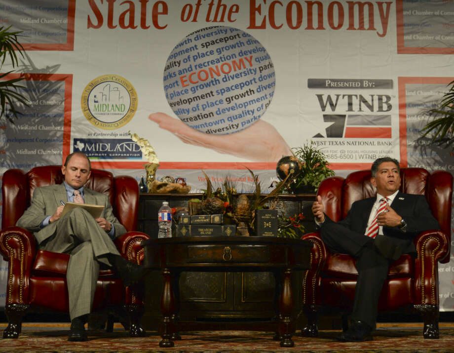 Cory Edmondson, board chairman of Midland Chamber, talks with Midland Mayor Jerry Morales Wednesday 11-4-2015 during the State of the Economy luncheon. Tim Fischer\Reporter-Telegram Photo: Tim Fischer