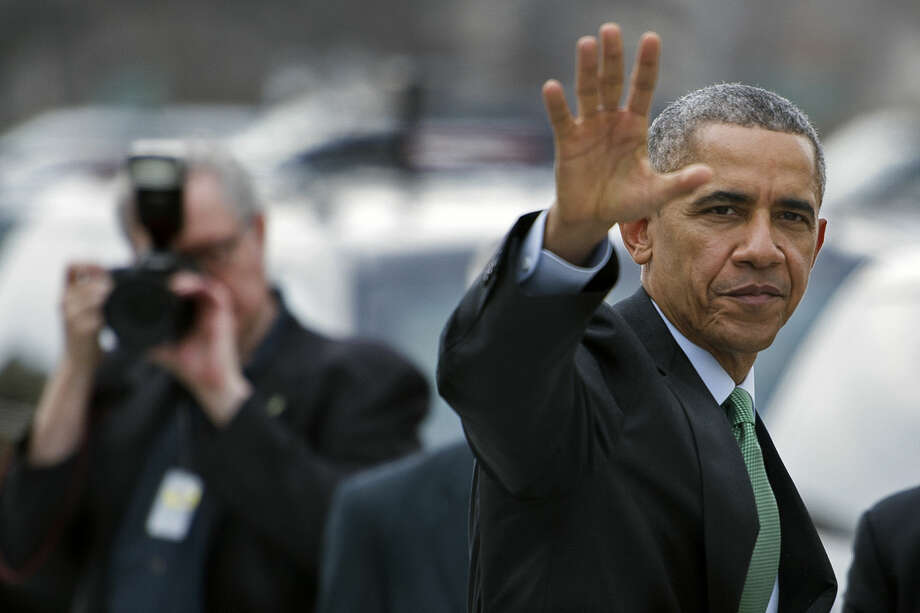 President Barack Obama waves as he departs Capitol Hill in Washington, on March 17, 2015, following a Friends of Ireland luncheon with Irish Prime Minister Enda Kenny. (AP Photo/Cliff Owen) Photo: Cliff Owen