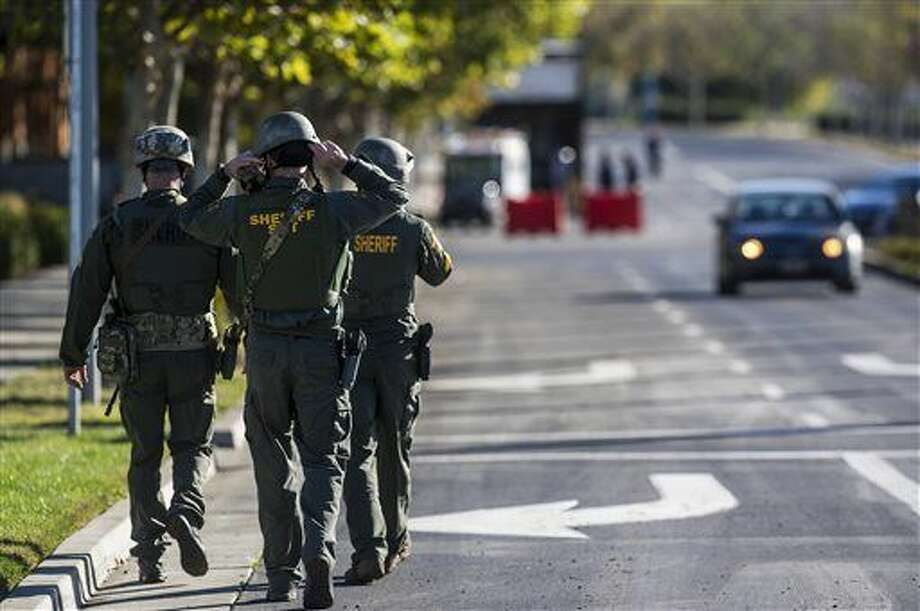 Merced County Sheriff SWAT members enter the University of California, Merced campus after a reported stabbing in Merced, Calif., Wednesday, Nov. 4, 2015. An assailant stabbed five people on the rural university campus in central California before police shot and killed him, authorities said Wednesday. (Andrew Kuhn/Merced Sun-Star via AP) Photo: Andrew Kuhn