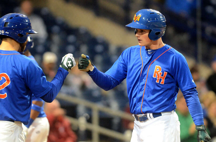 Rockhounds Matt Chapman (right) is congratulated by teammate Kent Matthes (left) after scoring a run against Tulsa on Saturday at Security Bank Ballpark in game four of the Texas League championship series. James Durbin/Reporter-Telegram Photo: James Durbin