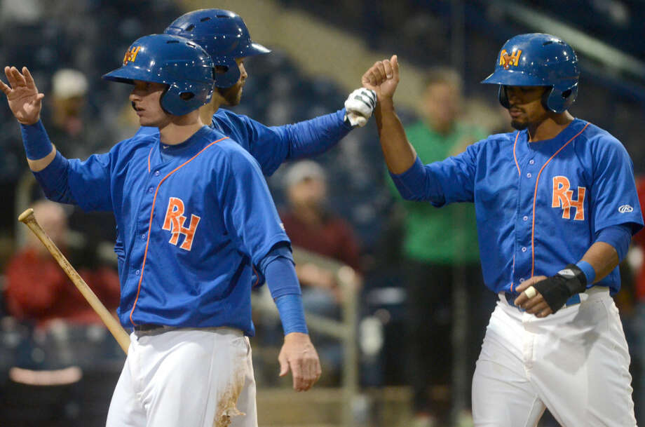 Rockhounds Daniel Robertson (left) and Kenny Wilson (right) celebrate after scoring runs against Tulsa on Saturday at Security Bank Ballpark in game four of the Texas League championship series. James Durbin/Reporter-Telegram Photo: James Durbin