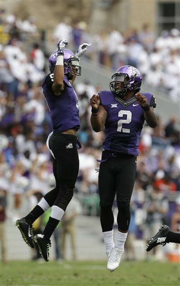 TCU wide receiver Josh Doctson (9) and quarterback Trevone Boykin (2) jump to celebrate connecting for a pass against Minnesota during the second quarter of an NCAA college football game, Saturday, Sept. 13, 2014, in Fort Worth, Texas. (AP Photo/LM Otero) Photo: LM Otero