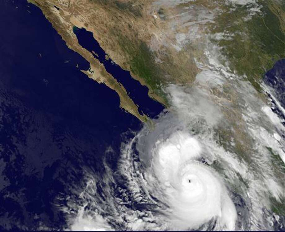 This satellite image provided by NOAA shows category four Hurricane Odile taken at 5:45 a.m. EDT Sunday Sept. 14, 2014. The rapidly strengthening Hurricane Odile intensified Saturday night and appeared headed for a possible close brush with the southern end of Mexico's Baja California peninsula. At 5 a.m. EDT Odile had maximum sustained winds of 135 mph and was moving north-northwest at 15 mph. (AP Photo/NOAA) Photo: HOPD