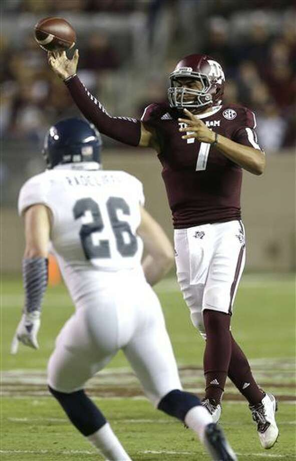 Texas A&M quarterback Kenny Hill (7) throws a pass as Rice linebacker James Radcliffe (26) defends during the second quarter of an NCAA college football game Saturday, Sept. 13, 2014, in College Station, Texas. (AP Photo/David J. Phillip) Photo: David J. Phillip