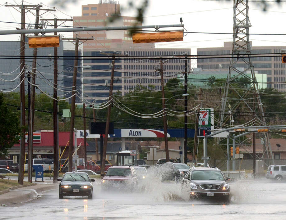 FILE PHOTO: Vehicles splash through standing water on A Street after a Sept. 5 shower. James Durbin/Reporter-Telegram Photo: James Durbin/Reporter-Telegram