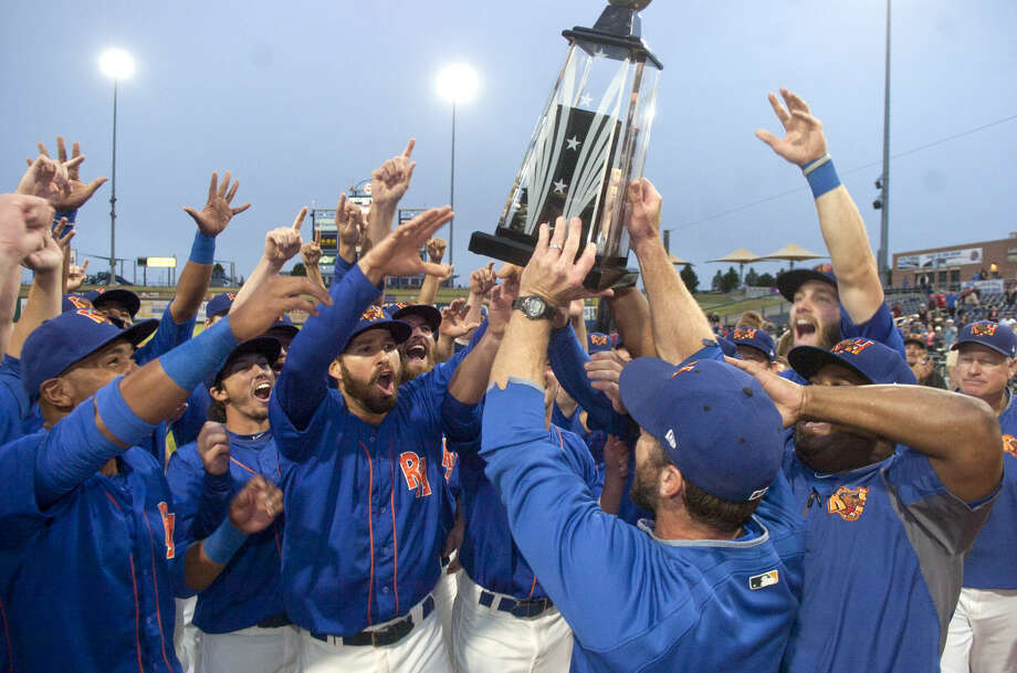 Rockhounds manager Aaron Nieckula presents the Bobby Bragan Texas League Championship Trophy to his team while celebrating a 5-0 win over Tulsa in the final game of the Texas League Championship series Sunday at Security Bank Ballpark. James Durbin/Reporter-Telegram Photo: James Durbin