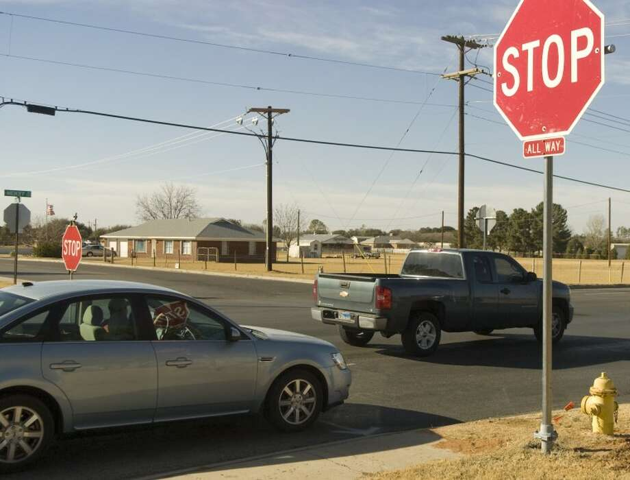 In this 2010 file photo, drivers pass through a four-way stop intersection at Midkiff Road and Bluebird Lane. Bynum Schools parents are pushing for a similar four-way stop intersection at Highway 158 and County Road 60. Photo: Tim Fischer/Midland Reporter-Telegram