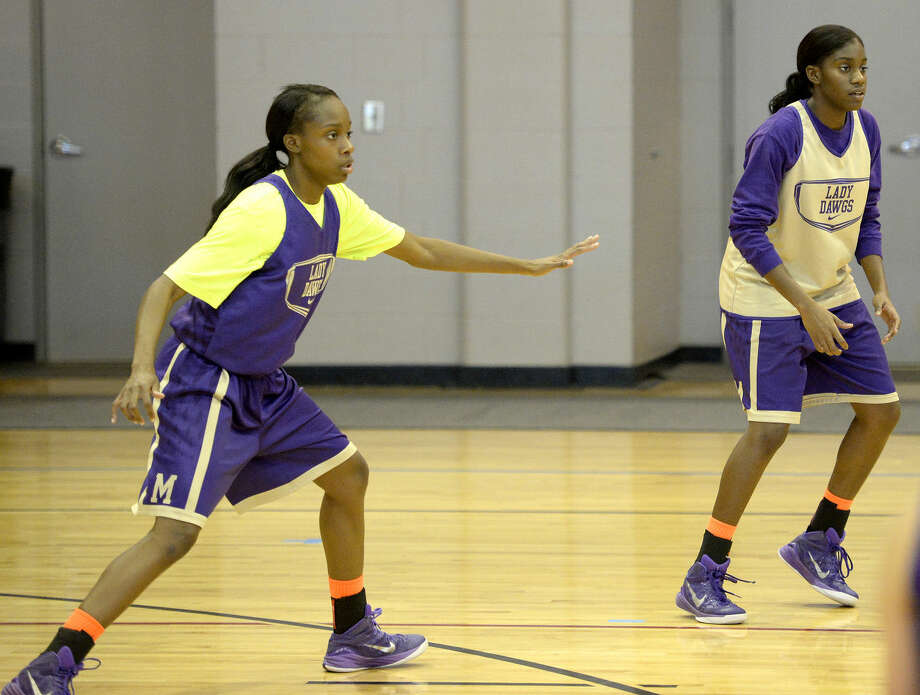 Midland High girls basketball teammates and sisters Alexis Washington (left) and Alexandrea Washington (right) during practice Thursday, Oct. 29, 2015, at First Presbyterian Church. James Durbin/Reporter-Telegram Photo: James Durbin