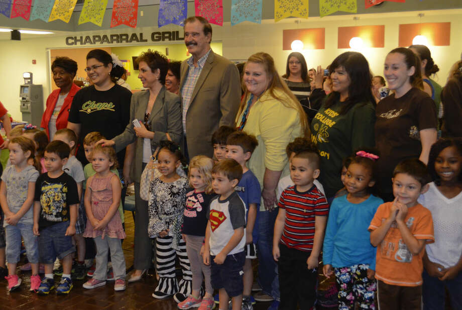 Marta and Vicente Fox, former President of Mexico, pose for pictures with MC day care students during a Diez y Seis celebration at Midland College Scharbauer Student Center Tuesday afternoon. Tim Fischer\Reporter-Telegram Photo: Tim Fischer