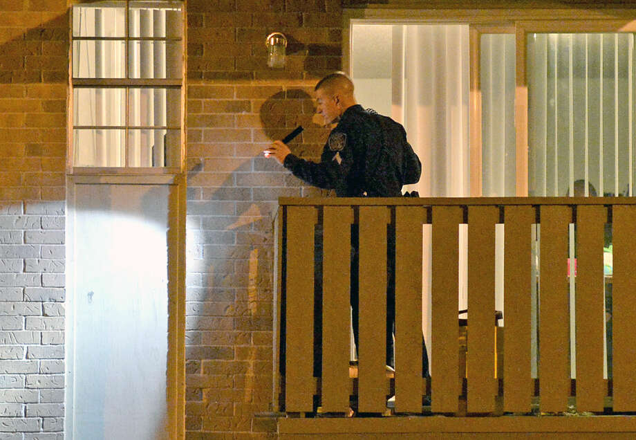 Midland public safety officials investigate an apartment at the Park Square complex where a 16-year-old male allegedly was injured by a negligent discharge of a firearm according to Sara Bustilloz, public information officer for the city of Midland, on Wednesday, Nov. 11, 2015. James Durbin/Reporter-Telegram Photo: James Durbin