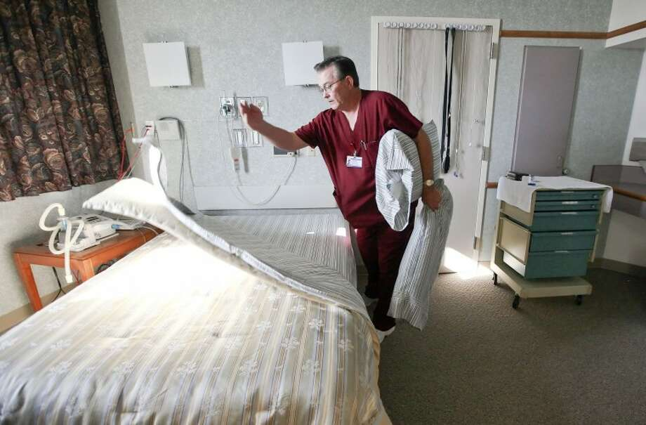 Registered Polysomnograpy Technologist Jerry Emerson prepares a room before a patient arrives to monitored for sleep disorders Tuesday at the Midland Memorial Hospital, Sleep Lab. Cindeka Nealy/Reporter-Telegram Photo: Cindeka Nealy