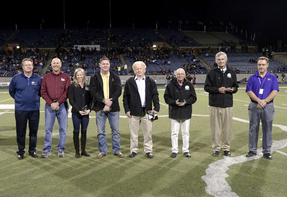 Group photo from left, MISD Superintendent Ryder Warren, Lee High principal Stan VanHoozer, Hall of Legends inductees Monica Tucker, Mike Stanton, Doss Rogers, Ed Nixon, Ross Montgomery, and Midland High principal Carlin Grammer, during a recognition ceremony before the start of the Lee High versus Midland High football game Friday, Nov. 6, 2015 at Grande Communications Stadium. James Durbin/Reporter-Telegram Photo: James Durbin