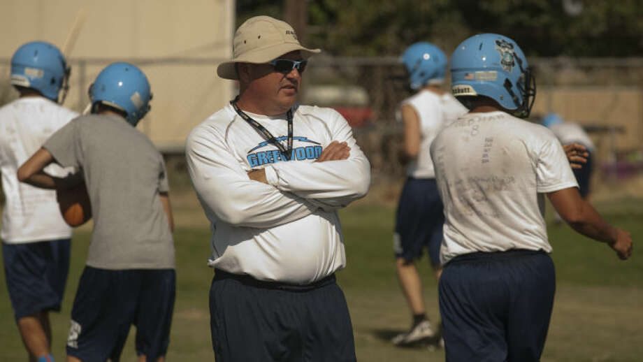 Greenwood coach Shad Hanna watches his players during the first practice Monday. Tim Fischer\Reporter-Telegram Photo: Tim Fischer