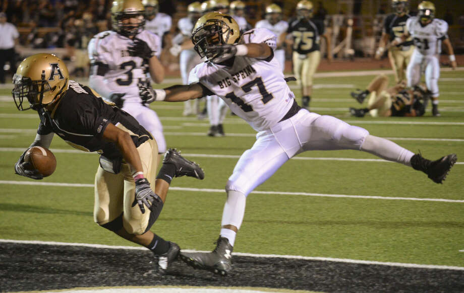 Andrews' Keegan Thompson grabs a reception for a touchdown as Big Spring's #17 defends Friday, Oct. 2, 2015 at Mustang Bowl in Andrews. Tim Fischer\Reporter-Telegram Photo: Tim Fischer