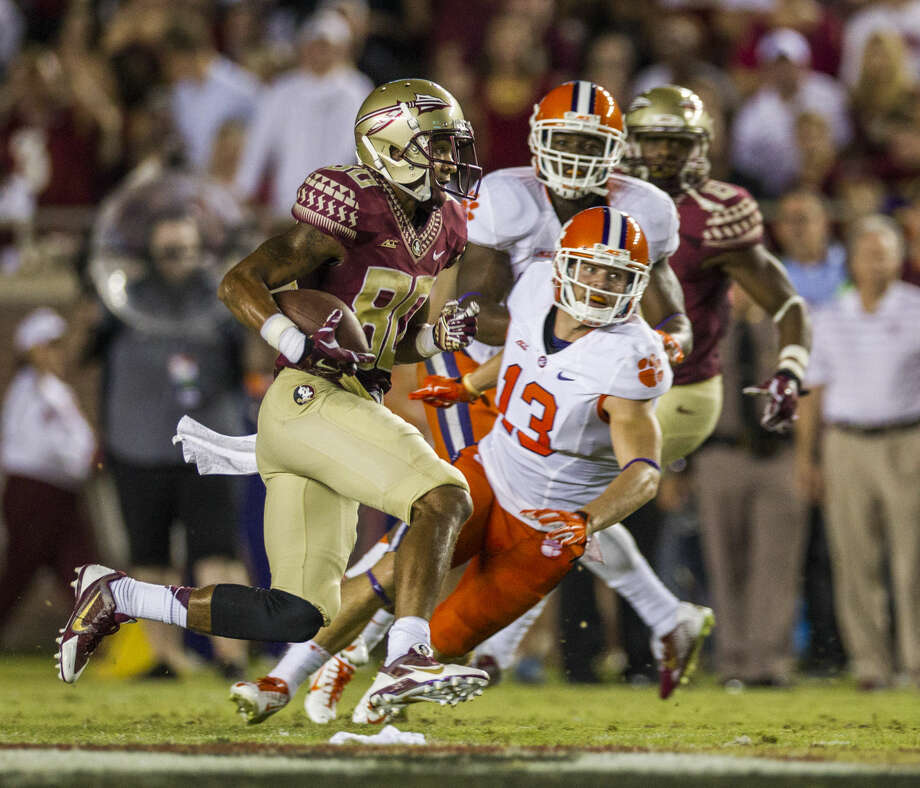 Florida State punt returner Rashad Greene takes off on a 28-yard return in the first half of an NCAA college football game against Clemson in Tallahassee, Fla., Saturday, Sept. 20, 2014. (AP Photo/Mark Wallheiser) Photo: Mark Wallheiser
