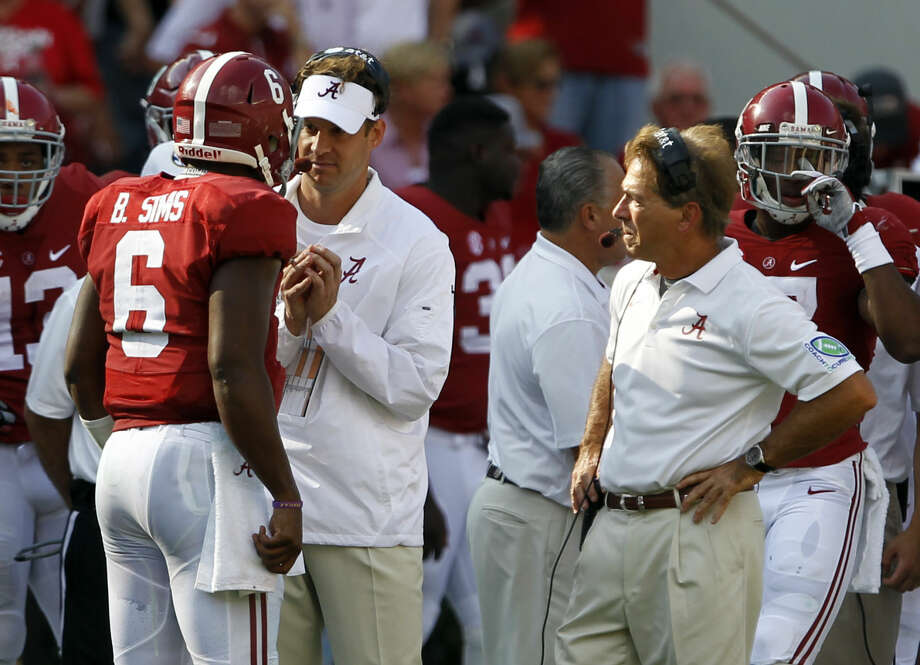 Alabama offensive coordinator Lane Kiffin talks with Blake Simms as Nick Saban listens in during the first half of an NCAA college football game against Florida on Saturday, Sept. 20, 2014, in Tuscaloosa, Ala. (AP Photo/Butch Dill) Photo: Butch Dill