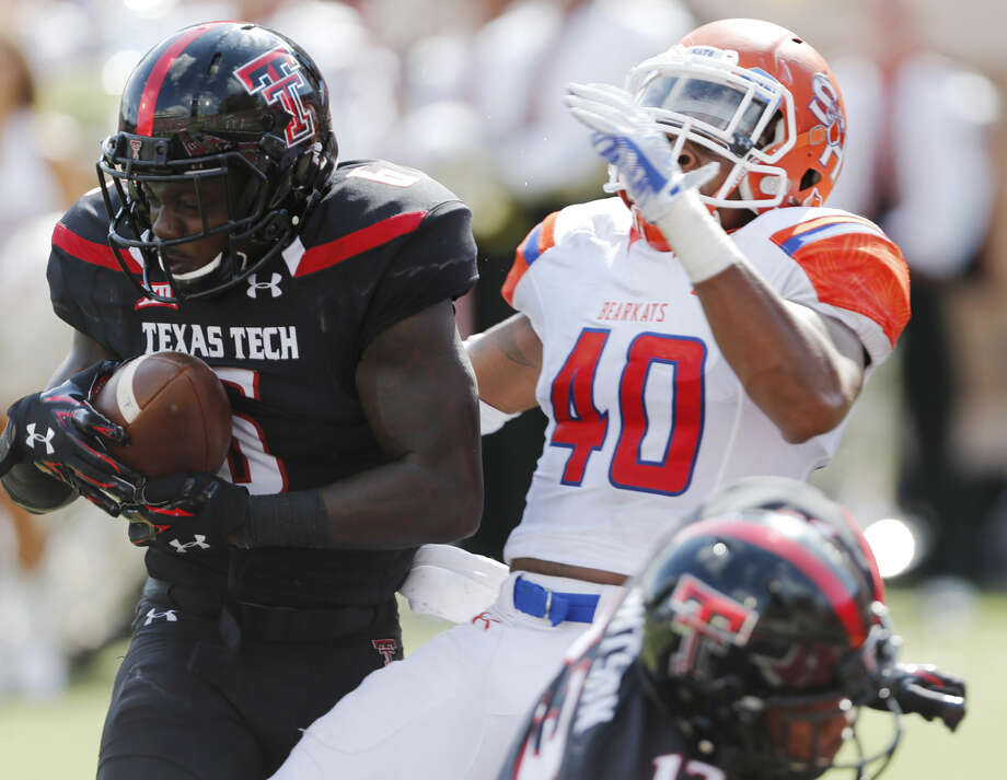 Texas Tech's Devin Lauderdale makes a catch for a touchdown as Sam Houston State's Sam Houston (40) defends during an NCAA college football game Saturday, Sept. 5, in Lubbock. (Mark Rogers/Lubbock Avalanche-Journal via AP) Photo: Mark Rogers