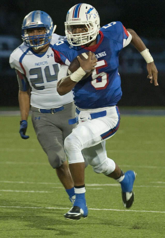 Midland Christian's Garry Powell scrambles for yards after getting around El Paso Americas' Manny Fierro Friday night at Mustang Field. Tim Fischer\Reporter-Telegram Photo: Tim Fischer