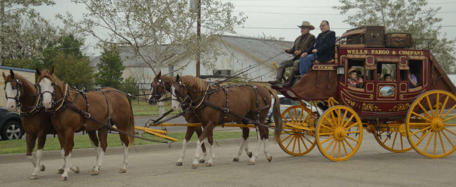 South Elementary students and teachers ride insode the Wells Fargo stagecoach as Principal J.R. Silva helps drive Thursday morning on the way to South Elementary. Tim Fischer\Reporter-Telegram Photo: Tim Fischer